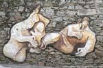 Orgosolo famille se reposant murales